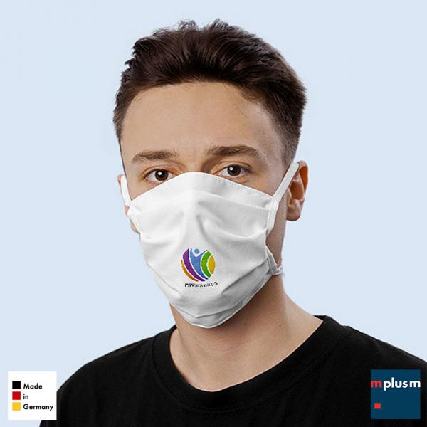 Mund- und Nasenmaske aus Baumwoll-Stoff. Aus Deutschland und ab 100 Stück als Werbeartikel mit Logo zu bedrucken.